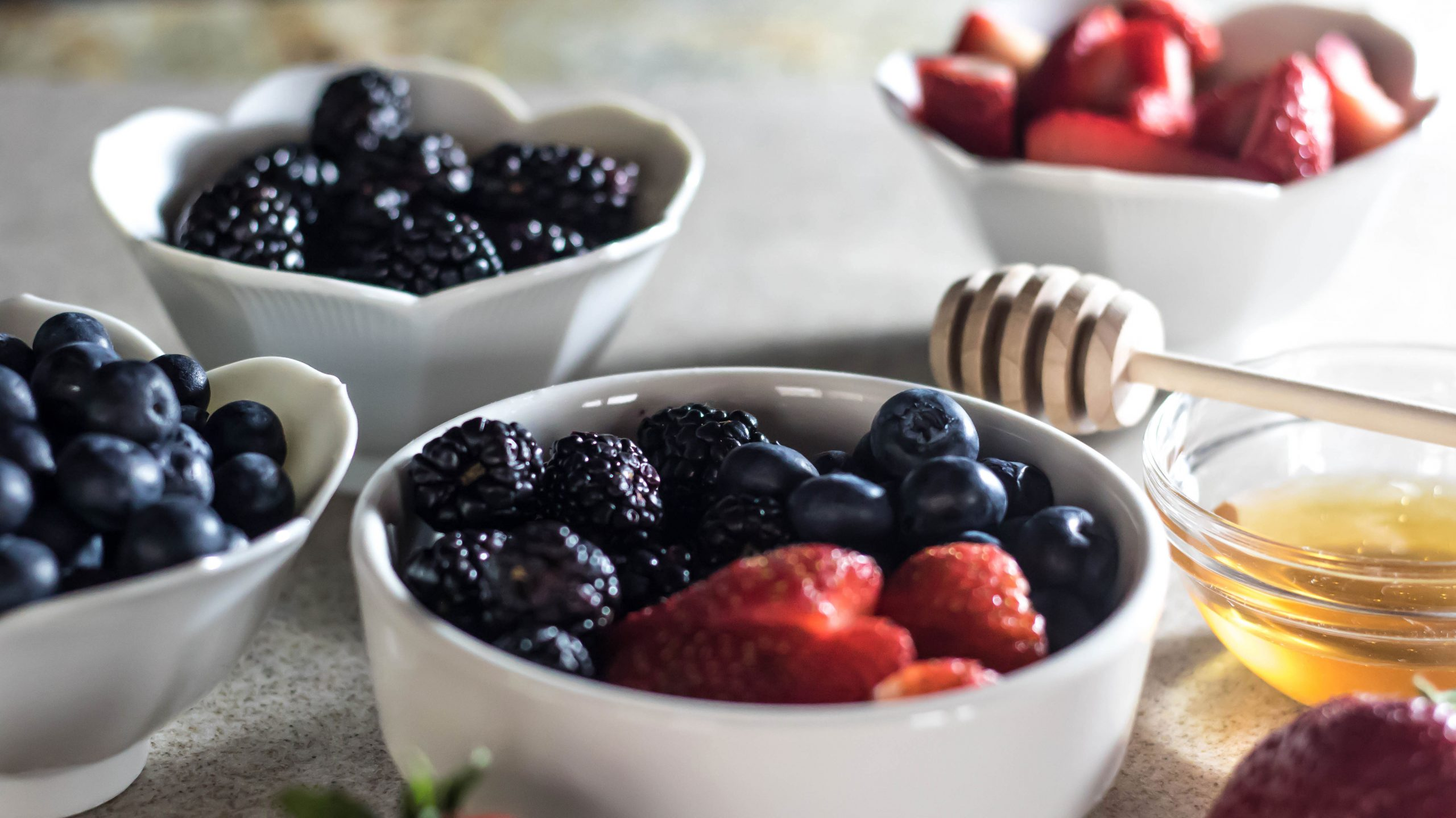 Fresh berries, whole cream, and raw honey make this simple treat delectable.